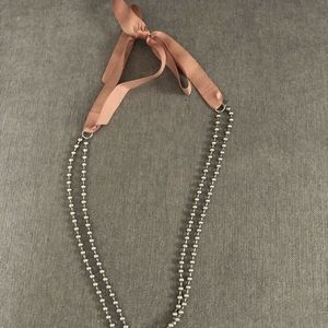 Bow and metal necklace